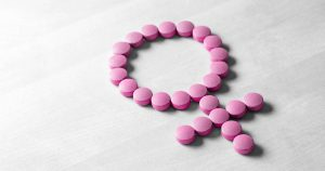 "Pink pills in the shape of ""female"" symbol"