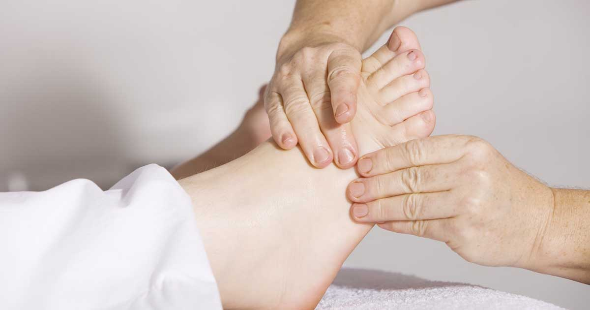 Woman getting foot massage.