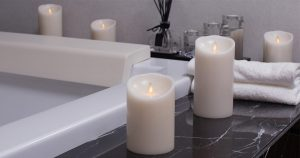 Lit candles by a bathtub