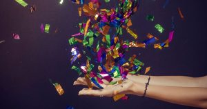Confetti falling into a woman's outstretched palms