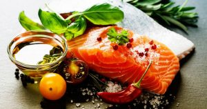 Plate with salmon and dressing on it