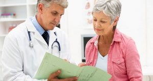Older woman looking at chart that her doctor is showing her